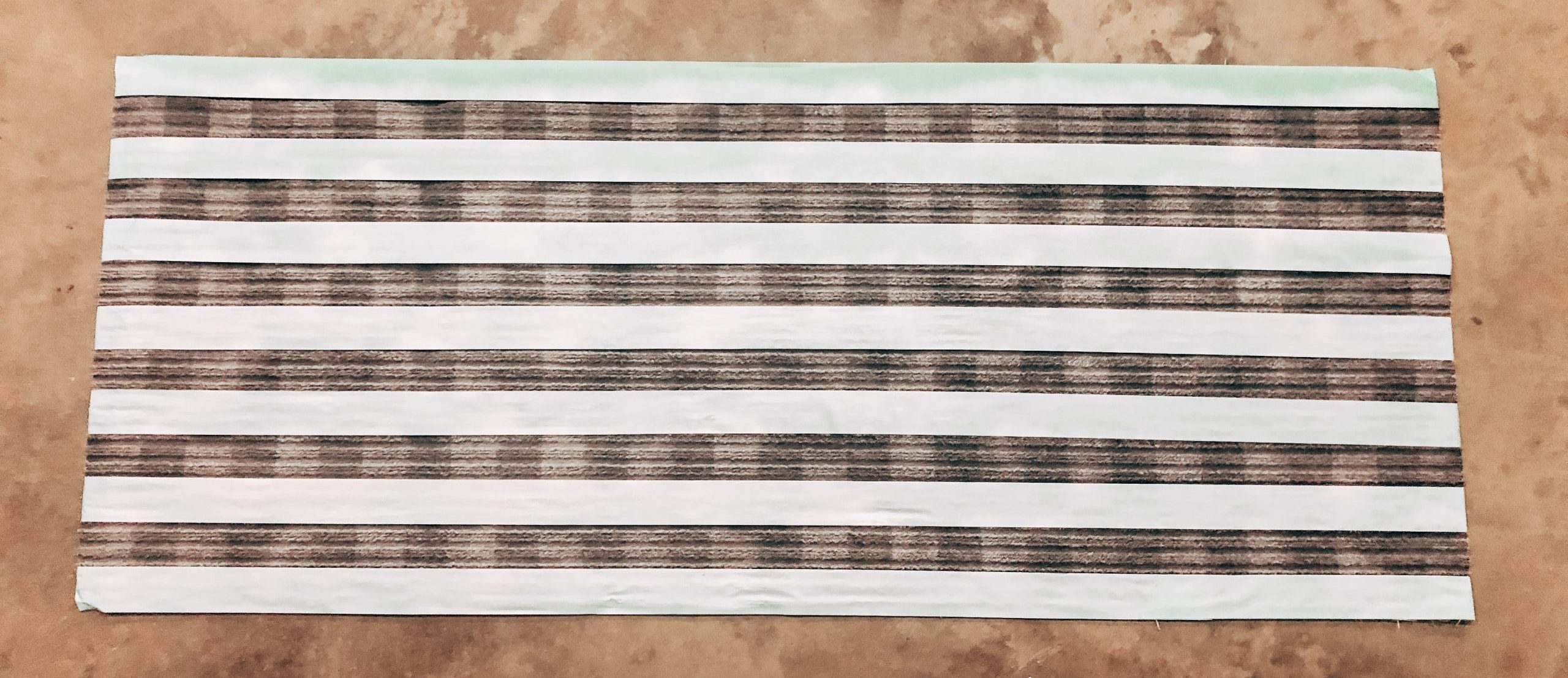 Searching for a buffalo check rug? Click to learn how to make a DIY buffalo check rug in less time than it will take you to source one!