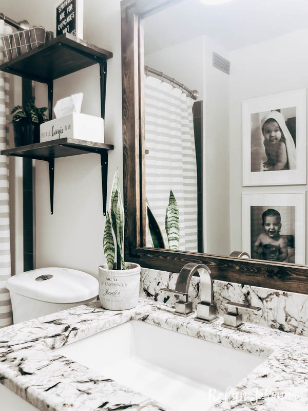 This modern farmhouse bathroom makeover reveal is packed with budget friendly DIY projects that will add style to any builder grade bathroom.